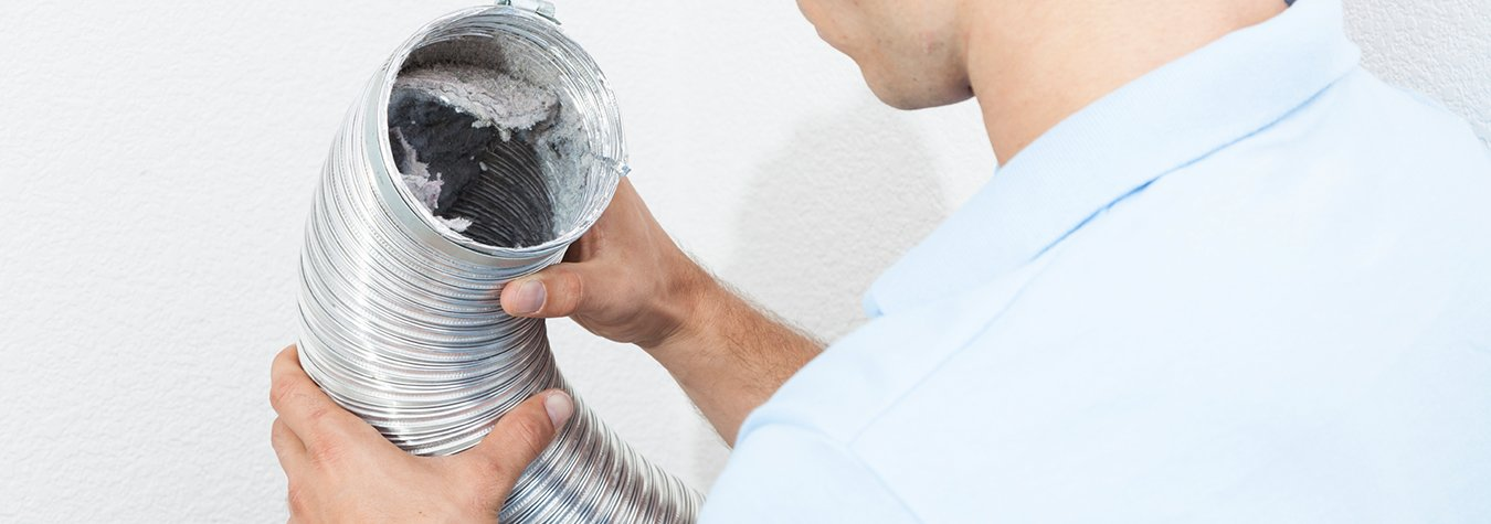 technician working on dryer vent cleaning